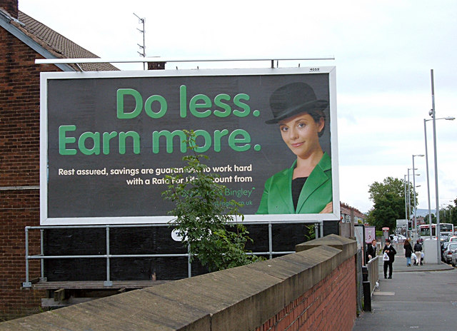"a billboard reading ""Do less. Earn more."""